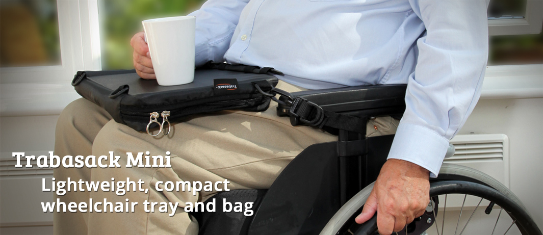 Photographic image of an elderly gentleman in a wheelchair, using Trabasack Mini as a tray