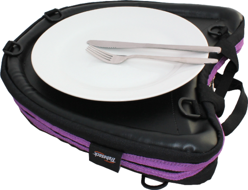 Image shows a Knork and knife upon a clean, white plate, which is being used on top of a Curve laptray bag