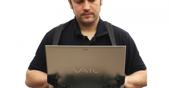 Man using a Trabasack Walking Desk with a Sont Vaio laptop