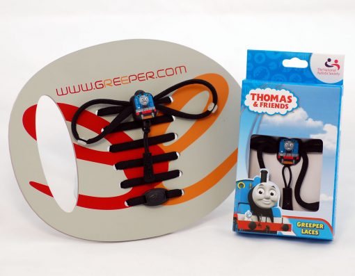 Photograph shows a packaged pair of Thomas the Tank Engine Greeper shoe laces, and a pair of example laces threaded through a cardboard display board
