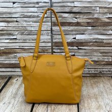 Image shows a photograph of a ladies shoulder bag in a bold Mustard yellow colour in front of and atop a wooden background