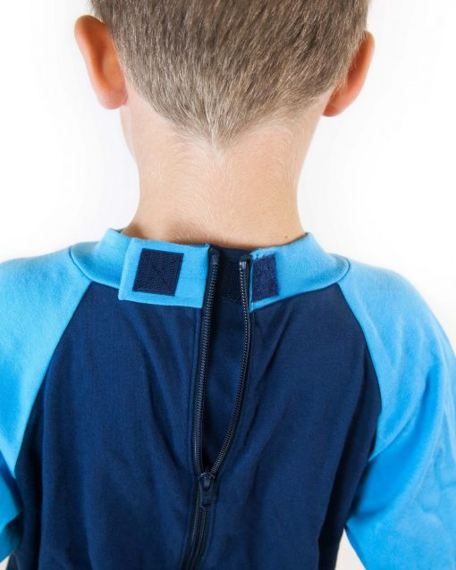 Image shows a photograph of the back of a boy's neck wearing the Seenin sleepsuit in navy and turquoise