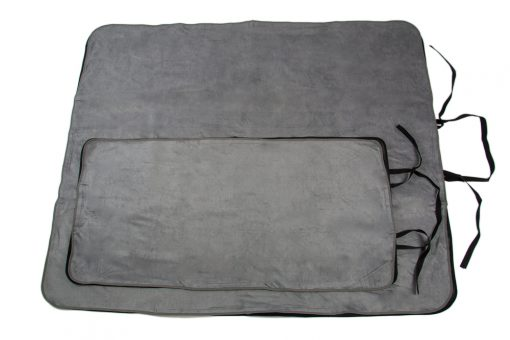 Image shows a photograph of a large grey Seenin mat lay flat on the floor, with regular sized mat on top to illustrate difference in size.
