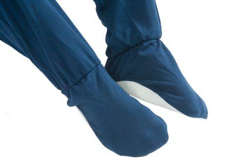 Image shows a photograph of the built-in non-sleep feet on a navy blue Seenin sleepsuit
