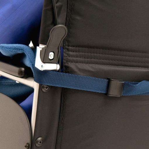 Image shows a photograph of the back of a wheelchair, showing the fleece leg cover strap attached around the back of the chair