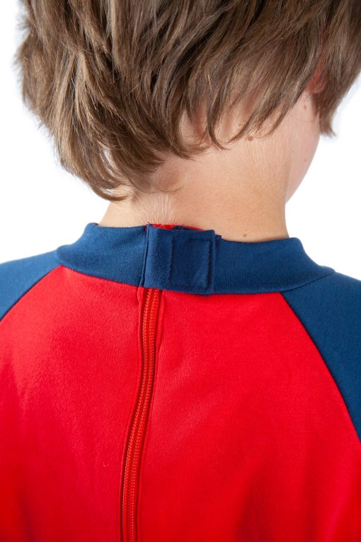 Image shows a photograph of the back of a boy's neck and shoulders, to illustrate the velcro-covered back zip of the Seenin jersey sleepsuit in navy and red