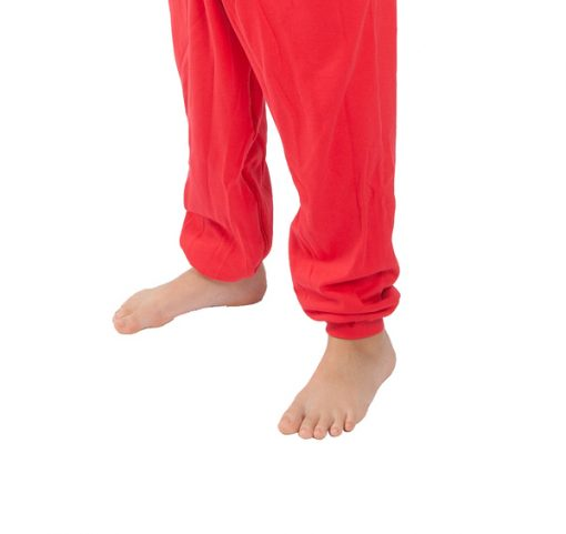 Image shows a photograph of the lower-legs of a boy wearing a footless Seenin sleepsuit in red