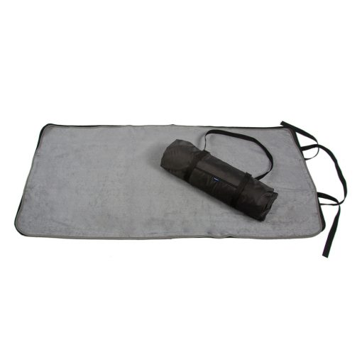 Image shows a Seenin grey bamboo towelling changing mat lay flat on the floor with a rolled-up changing mat on top.