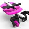 Image is a photograph that shows the Skoe Hitch in pink neatly and compactly folded flat for storage or travel
